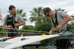 49er sailors rig their sailboat